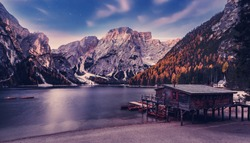 Incredible view on majestic famouse lake Braies in night. Wonderful dramatic landscape in dolomites Alps with starry sky. Amazing nature Scenery. fantastic night nature scenery in autumn moutains.