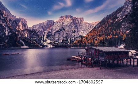 Photo of  Incredible view on majestic famouse lake Braies in night. Wonderful dramatic landscape in dolomites Alps with starry sky. Amazing nature Scenery. fantastic night nature scenery in autumn moutains.