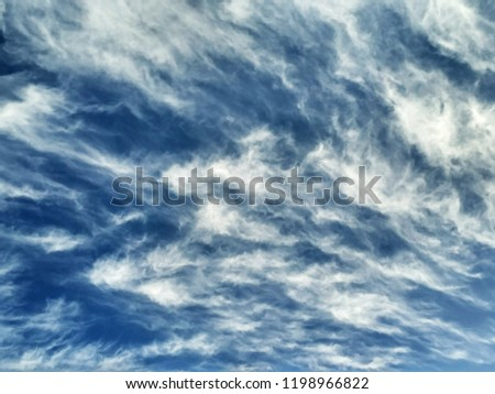 Incredibly beautiful curly wavy clouds. Unusual breathtaking texture of the cloudy sky. Heaven scenic atmospheric photo #1198966822
