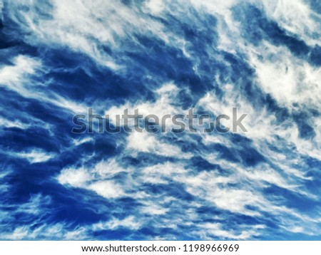 Incredibly beautiful curly wavy clouds. Unusual breathtaking texture of the cloudy sky. Heaven scenic atmospheric photo #1198966969