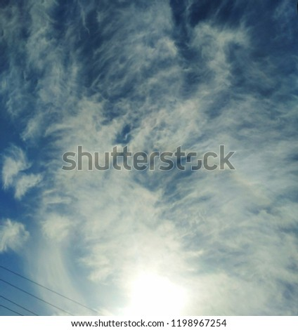 Incredibly beautiful curly wavy clouds. Unusual breathtaking texture of the cloudy sky. Heaven scenic atmospheric photo #1198967254