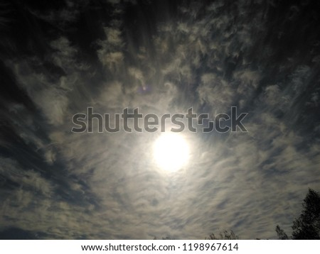 Incredibly beautiful curly wavy clouds. Unusual breathtaking texture of the cloudy sky. Heaven scenic atmospheric photo #1198967614