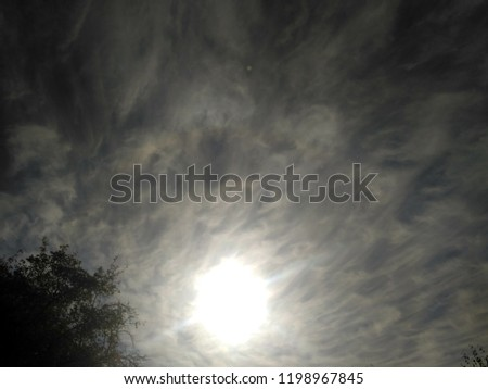Incredibly beautiful curly wavy clouds. Unusual breathtaking texture of the cloudy sky. Heaven scenic atmospheric photo #1198967845
