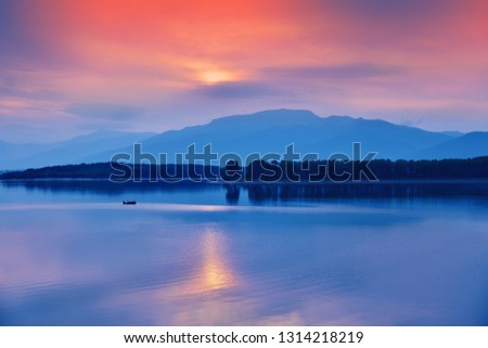 Incredibly beautiful sunset.Sunrise landscape, panorama of beautiful nature.Blue Sky with amazing colorful clouds.Water reflections.Magic Artistic Wallpaper.Creative Background.Tranquil lake.