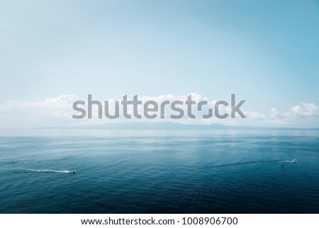 Incredibly blue sea and blue sky landscape in Greece #1008906700