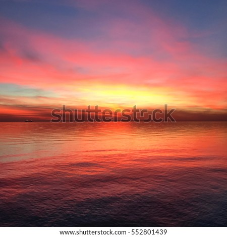 Incredibly Colorful sunset at Trieste Italy. Raibow color at a rock beach. #552801439