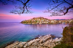 Incredibly romantic sunny spring seascape on Aegean Sea. Colorful morning view of Kavala city, eastern Macedonia, Greece, Europe.Beach view in Greece. Beautiful Kavala's view.