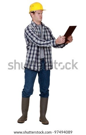Incredulous tradesman looking at a clipboard