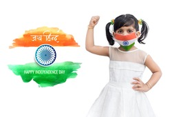 Independence Day (15 august) - Indian girl in white dress with braided hair, wearing tri color face mask of Indian flag raising her fist. Celebrating Indian Independence day