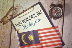 Independence Day Malaysia wording with Malaysia flag