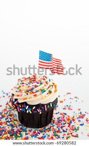 Independence Day Themed Cupcake with Lots of Red, White and Blue  Sprinkles plus US Flag