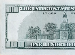 Independence Hall on 100 dollars banknote back side closeup macro fragment. United states hundred dollars money bill