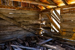 Independence Pass mining townsite wooden cabin interior with sunlight through window in White River National Forest in Colorado