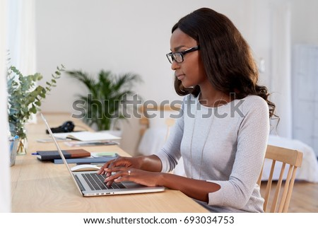 independent confident woman typing on computer laptop, working from home young entrepreneur
