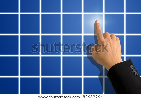 Index finger in black suit pointing on blue square