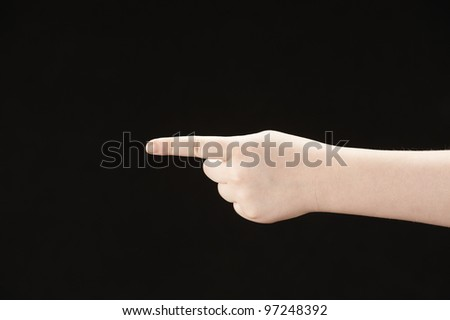 Index finger pointing - girls hand - stock photo