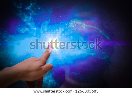 Index finger touches a touch screen and creates light and space effects. #1266305683
