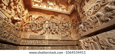 India Belur temple. Old stone wall with sculptures.