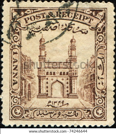 INDIA - CIRCA 1934: A stamp printed in Hyderabad shows Charminar, the literal translation - The Mosque  of Four Minarets or Four Towers, Andhra Pradesh, circa 1934
