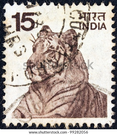 INDIA - CIRCA 1974: A stamp printed in India shows a Bengal tiger, circa 1974.