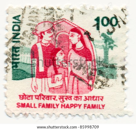 """INDIA - CIRCA 1994: A stamp printed in India, shows Family of 3 in front of house with the inscription """"small family happy family"""", circa 1994"""