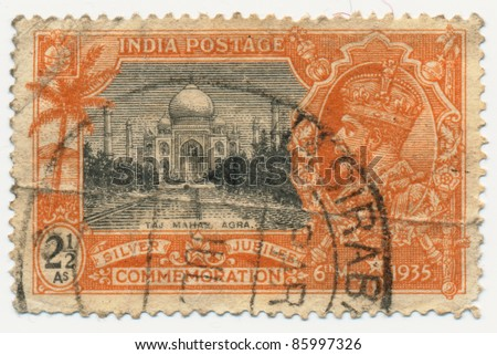 INDIA - CIRCA 1935: A stamp printed in India, shows Taj Mahal, Agra and portrait king of George V, circa 1935
