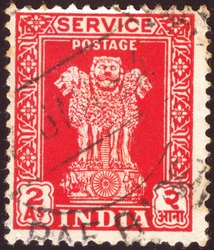INDIA - CIRCA 1950: Cancelled postage stamp printed by  Indian mind shows four Indian lions capital of Ashoka Pillar, circa 1950.