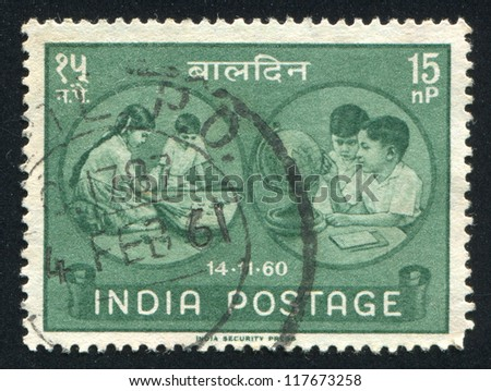 INDIA - CIRCA 1960: stamp printed by India, shows children, globe and game, circa 1960