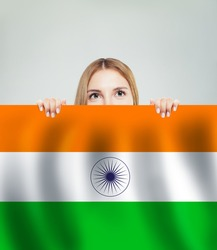 India concept. Happy woman with India flag background. Travel and learn hindi language