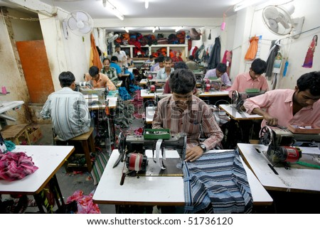 INDIA - FEB 26: Textile workers in a small factory in Old Delh on February 26, 2008 in Delhi, India. Many small factories provide the West with their clothes.