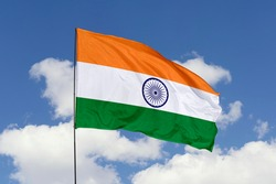 India flag isolated on the blue sky with clipping path. close up waving flag of India. flag symbols of India.