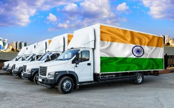 India flag on the back of Five new white trucks against the backdrop of the river and the city. Truck, transport, freight transport. Freight and Logistics Concept