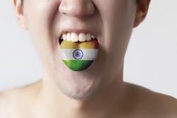 India flag painted in tongue of a man - indicating Hindi or Tamil language and speaking