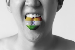India flag painted in tongue of a man - indicating Hindi or Tamil language and speaking in Black and White