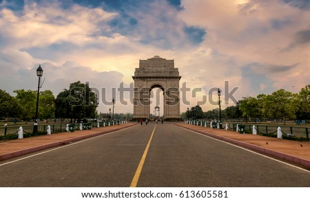 India Gate a war memorial built on the eastern end of Rajpath road New Delhi at sunset time. #613605581