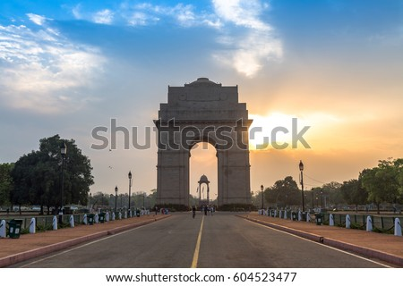 India Gate Delhi at sunrise with a vibrant moody sky. The India Gate, is a war memorial located on the east side of Rajpath road and an important city landmark. #604523477