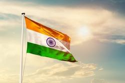 India national flag cloth fabric waving on the sky with beautiful sun light - Image