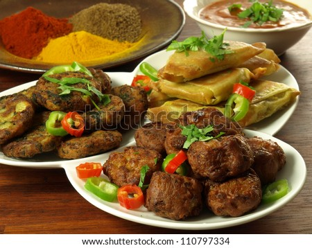 Indian appetizers with bowl of dip and spices