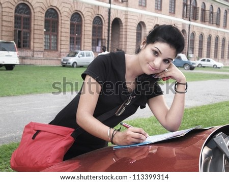Indian / Asian college student studying in campus.