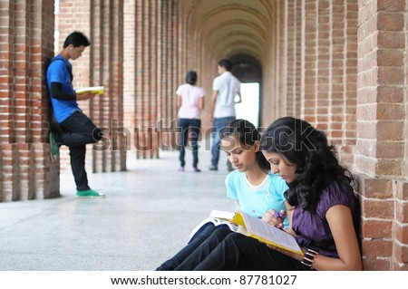 Indian / Asian College students preparing for examination.