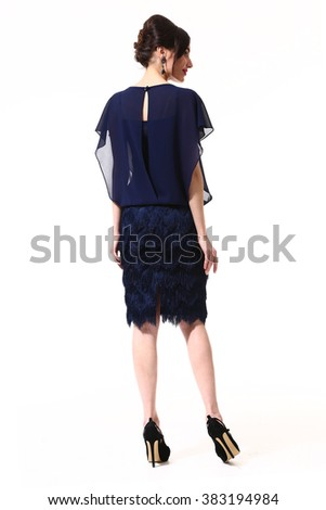 indian asian eastern brunette business executive woman with straight hair style in blue formal party cocktail dress  high heels shoes full length body portrait standing isolated on white back view
