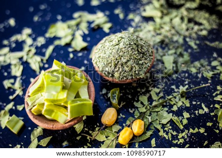Indian Ayurvedic face pack best to cure acnes and pimple along with black heads i.e. Face pack or ubtan of Neem or iilac and aloe vera with Neem fruit on wooden surface.