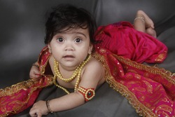 Indian Baby Girl With Jewelry, Smiling Face, Fair Tone, Traditional Jewelry, Pearls, Pearl Necklace, Artificial Jewelry, Smiling Kid