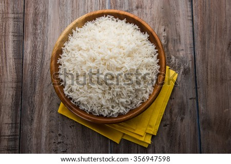 Shutterstock indian basmati rice, pakistani basmati rice, asian basmati rice, cooked basmati rice, cooked white rice, cooked plain rice in wooden bowl over brown wooden background