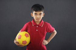 Indian boy holding football