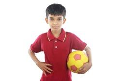 Indian boy holding football