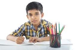 Indian boy with drawing note and pencil