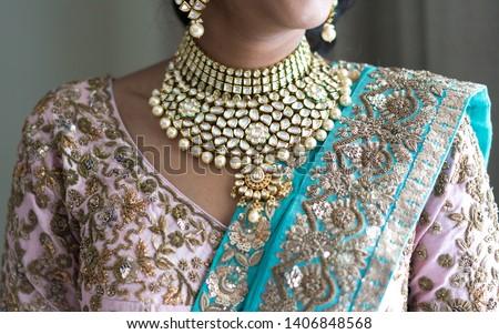 Indian bridal showing wedding Kundan necklace #1406848568