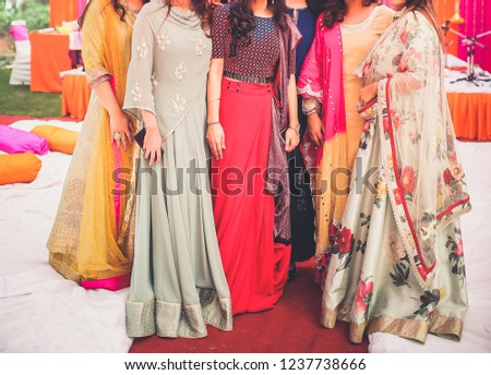 Indian bride and bridesmaid showing wedding Lehnga Skirts dress #1237738666