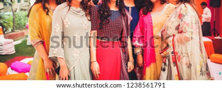Indian bride and bridesmaids posing with their sangeet outfits Karachi, Pakistan, November 22, 2018 #1238561791